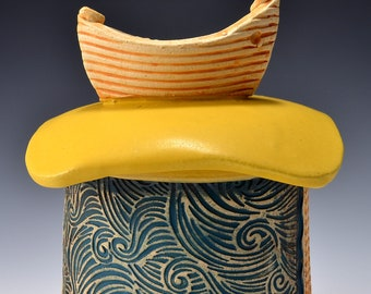 Small Sculptural Stoneware Jar with Dory Boat Knob on the lid, Rubbed back green-brown stain, matte turmeric yellow glaze by Tom Bottman