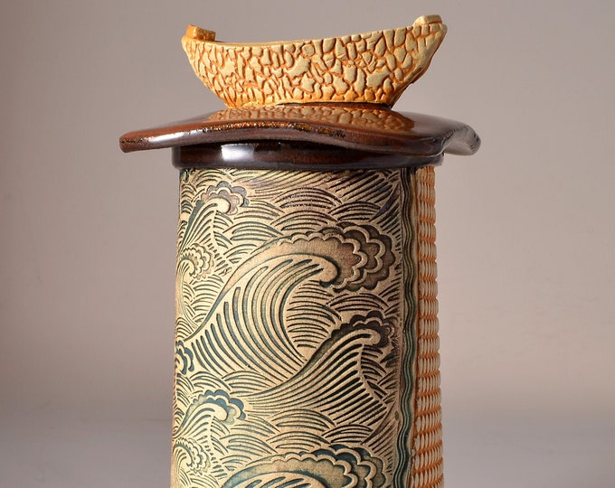 Tall Textured Covered Jar, Lighthouse shaped- Copper Metallic Red Glaze with Textured Outside Stained with blue-green Pigment