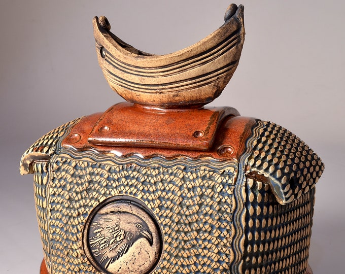 Sculptural Stoneware Jar with Dory Boat Knob on the lid, Rubbed back yellow-brown stain, copper metallic glaze