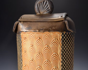 Tall Sculptural  Samurai Jar with lid, Rubbed back black and yelllow stain, metallic gold glaze by Tom Bottman