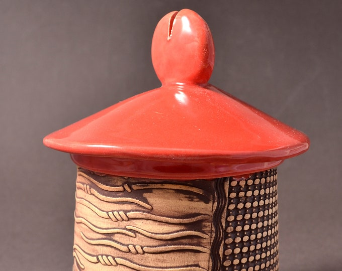 Short Textured Covered Jar, Lighthouse shaped- Red Gloss Glaze with Textured Outside Featuring Brown Stain rubbed back