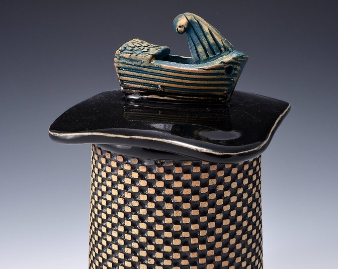 Medium Sculptural Stoneware Jar with Little Boat Knob on the lid, Rubbed back black stain, gloss black glaze by Tom Bottman