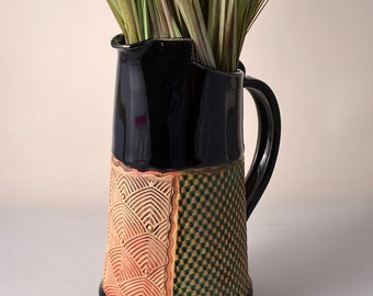 Tall Pitcher Stoneware with Black Patent Glaze and Unglazed Exterior Texture with a yellow and redish brown colored pigment