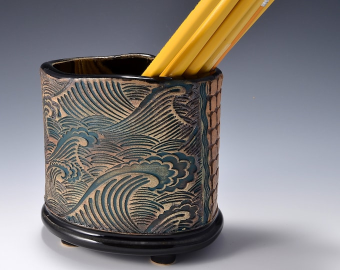 Oval Desktop Pencil and Pen holder in Gloss Black Glaze and Lively Textured Exterior with Crashing Wave Image by Tom Bottman