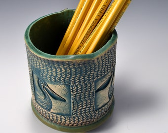 Oval Desktop Pencil and Pen holder in matte copper green Glaze and Lively Textured Exterior with pelican Image by Tom Bottman