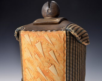 Sculptural Samurai Jar with lid, Rubbed back yellow and brown stain, Mettalic GOld glaze inside, on the lid, and on the foot and base.