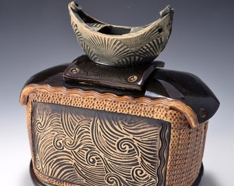 Sculptural Stoneware Jar with Boat Knob on the lid, Rubbed back ambrosia yellow stain, Crashing Wave image with Ancient Jasper glaze