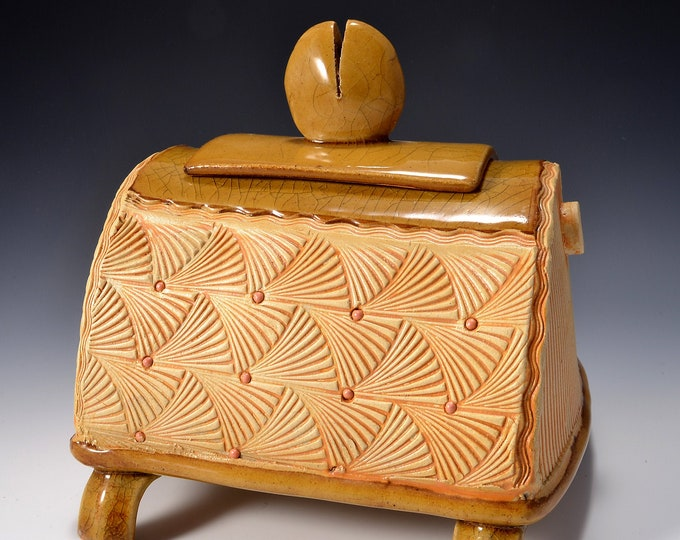 Sculptural Stoneware Jar with lid, Rubbed yellow brown stain, Crazed amber glaze inside, on lid, and on the foot and base. By Tom Bottman