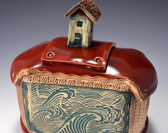 Sculptural Stoneware Jar with Beach Cottage Knob on the lid, Rubbed back red-brown stain, Crashing Wave image with Firebrick red glaze
