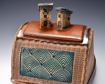 Sculptural Stoneware Jar with Village House Knobs on the lid, Rubbed back red-brown stain, ancient copper glaze