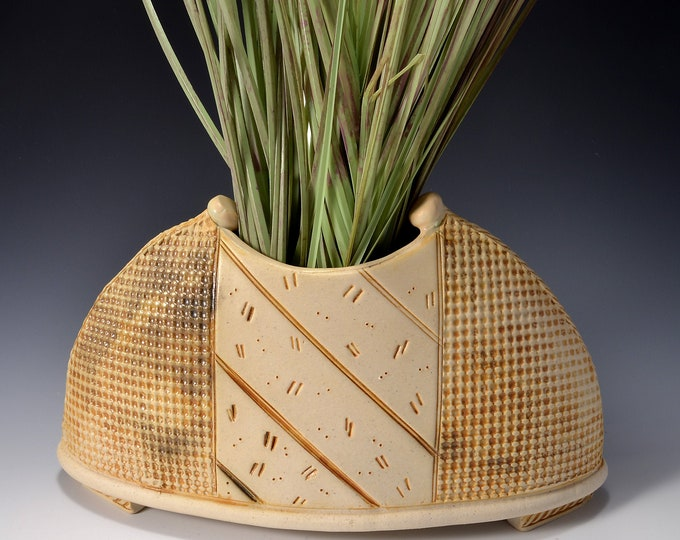 Large Size Vase, Half Moon Shape, Outside Texture Pattern with center panel of Diagonal lines and dashes. Rustic yet modern.