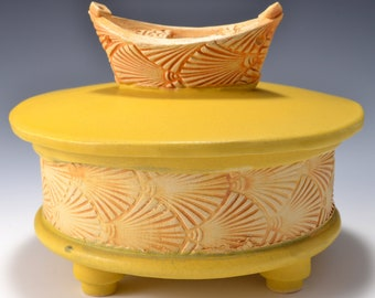 Sculptural Stoneware Jar with Little Boat Knob on the lid, Rubbed back ambrosia yellow stain, matte turmeric yellow glaze by Tom Bottman