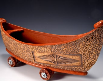 Large Stoneware Dory Boat with Wheels Matte Paprika Red glaze inside and rustic red-brown stained outside by Tom Bottman