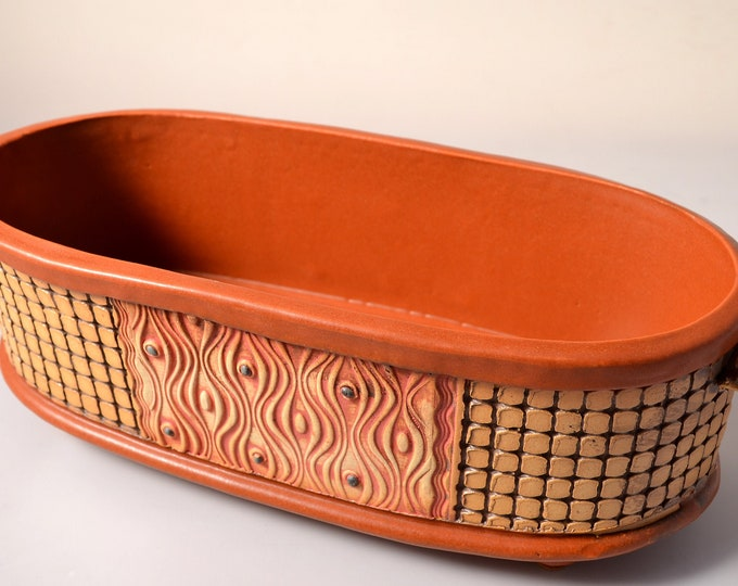 Large Long Serving bowl with Satin Paprike Red glaze and stained and textured exterior with wavy abstract pattern