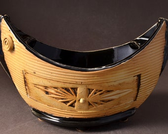 """Small """"Elven Boat"""" shaped bowl with gloss balck glaze inside and Yellow Brown stained outside with medallion and inset colored clay dot"""