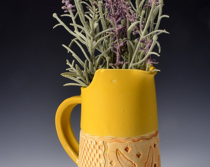 Medium Size Pitcher Stoneware with Turmeric Yellow Glaze and Unglazed Exterior Feather Pattern Texture with a warm yellow colored pigment