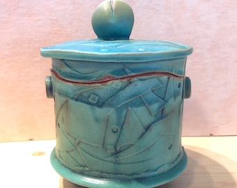 Medium Size Round Covered Jar, Cubist Art Deco Impressed Pattern covered with a Copper Green Matte glaze that accents the design