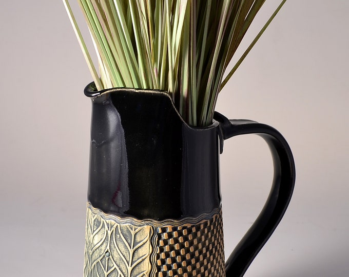 Tall Pitcher Stoneware with Black Patent Glaze and Unglazed Exterior Leaf Pattern Texture with a warm green colored pigment