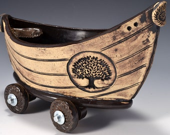 Small Stoneware Dory Boat with Wheels Ancient Jasper glaze inside and rustic red-brown stained outside with raven image