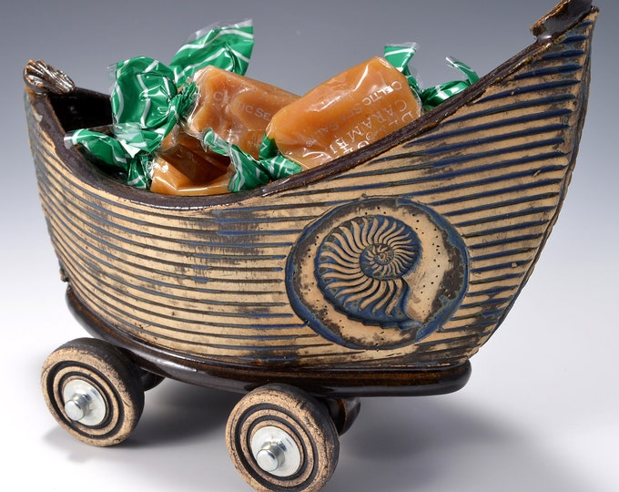 Small Stoneware Dory Boat with Wheels Ancient Jasper glaze inside and rustic black-blue stained outside with Nautilus Shell image