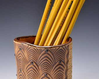 Oval Desktop Pencil and Pen holder in Ancient Copper Glaze and Lively Textured Exterior with Stylized Feather Image by Tom Bottman