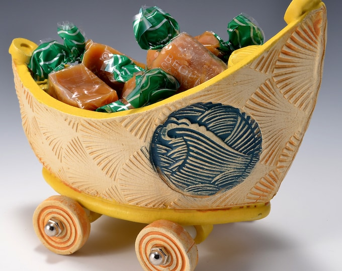 Small Stoneware Dory Boat with Wheels Turmeric Yellow glaze inside and Ambrosia Yellow stained outside with Crashing Wave images
