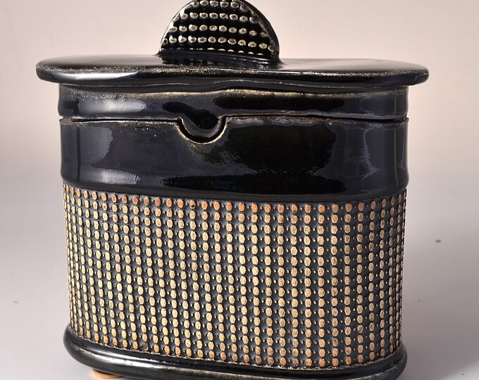Medium Size Oval Covered Jar, Black Stain on Unglazed Exterior with Overall Pattern, Gloss Patent Black Glaze on Lid, Foot and Inside
