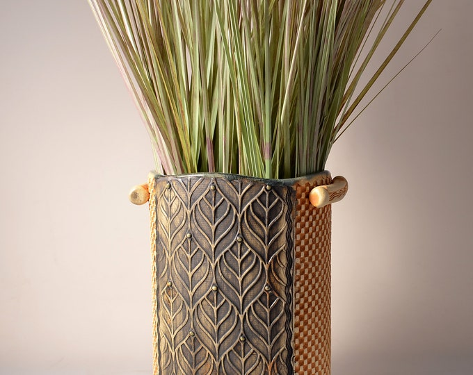 Tall Oval Vase, Stoneware with Crazed Celadon Glaze and Unglazed Exterior Texture with a green and wheat colored pigment with leaf design