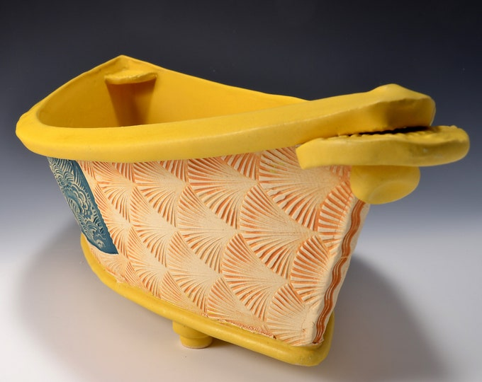 "Large ""Dory"" Shaped Long Serving bowl with Matte Turmeric Yellow glaze and stained and textured exterior with ocean images by Tom Bottman"