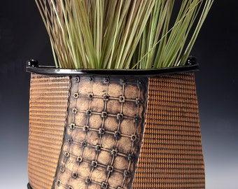 Tall Flattened Oval Vase, Stoneware with Gloss Black Glaze and Unglazed Outside Texture Stained with black-red-brown pigments by Tom Bottman