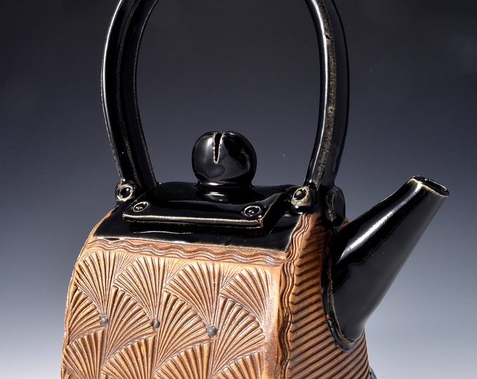 Small Teapot with Inset stylized fan Pattern, finished with Paprika Red Ceramic Stain and a Gloss Black Patent Glaze by Tom Bottman