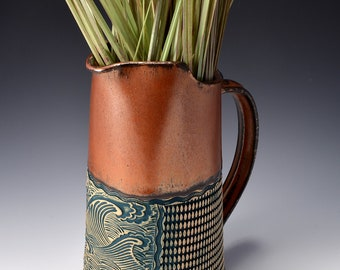 Tall Pitcher Stoneware with Ancient Copper Red Glaze and Unglazed Exterior Crashing Waves Texture with a dark green-blue colored pigment