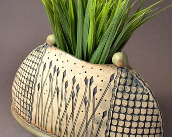 Large Size Vase, Half Moon Shape, Outside Texture Pattern with center panel of stylized reeds Matte Green glaze. Rustic yet modern.