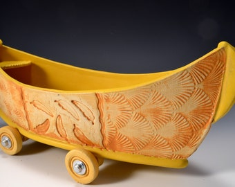 Large Stoneware Dory Boat with Wheels Turmeric Yellow glaze inside and rustic red-brown stained outside by Tom Bottman