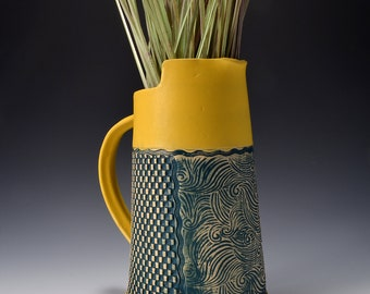 Tall Pitcher Stoneware with Turmeric Yellow Glaze and Unglazed Exterior with a Swirling Wave Texture with a dark green-blue colored pigment