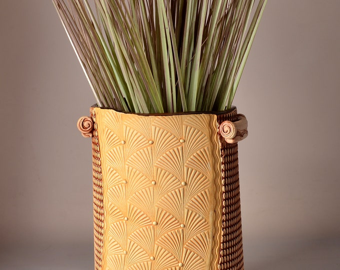 Tall Oval Vase, Stoneware with Metallic copper Glaze and Unglazed Exterior Texture with a wheat colored pigment with waving fans design
