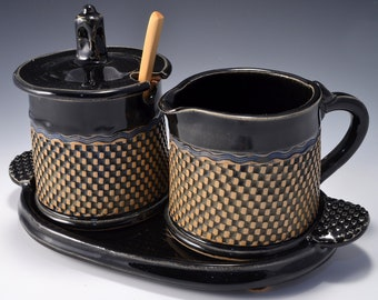 Sugar and Cream Set Gloss Black Patent Glaze With Black Stain wiped back on a geometric pattern. by Tom Bottman