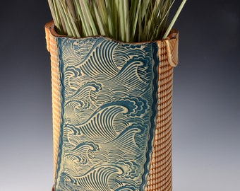Tall Oval Vase, Stoneware with Metallic Ancient Jasper Glaze and Unglazed Exterior Texture with a crashing wave pattern