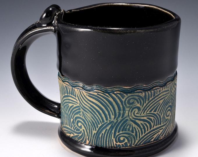 Stoneware Mug with Impressed Pattern of Crashing Waves, Black Patent Gloss Glaze - 12 ounces by Tom Bottman