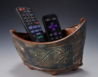 """Small """"Elven Boat"""" shaped bowl with ancient copper glaze inside and rustic weathered looking stained outside with crashing wave pattern"""