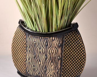 Unique Oval Vase Glaze and Unglazed Exterior Texture with a Black pigments stain.