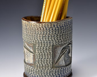 Oval Desktop Pencil and Pen holder in Ancient Jasper Glaze and Lively Textured Exterior with heron Image by Tom Bottman