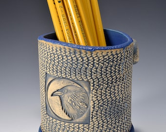 Oval Desktop Pencil and Pen holder in Ancient Jasper Glaze and Lively Textured Exterior with crow Image by Tom Bottman