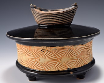 Sculptural Stoneware Jar with Little Boat Knob on the lid, Rubbed back ambrosia yellow stain, gloss black glaze by Tom Bottman