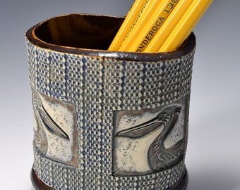 Oval Desktop Pencil and Pen holder in Ancient Jasper Glaze and Lively Textured Exterior with pelican Image by Tom Bottman