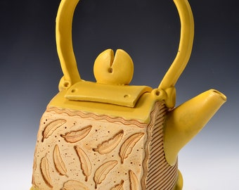 Small Teapot with Inset Feather Pattern, finished with Yellow Ambrosia Ceramic Stain and a Matte Yellow Turmeric Glaze