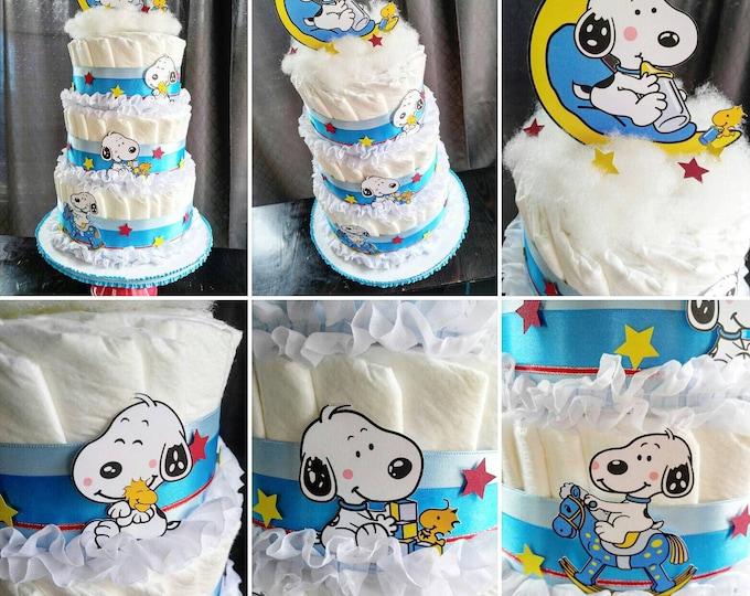Featured listing image: Snoopy Diaper Cake - The Peanuts Diaper Cake - Charlie Brown - Snoopy Baby Shower - Baby Snoopy - Baby Snoopy Baby Shower - Diaper Cake