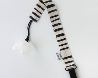 Off-white pacifier clip with black print