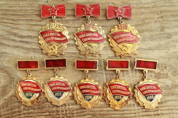 set of 8 Soviet  Pins Winner of Socialist Competit
