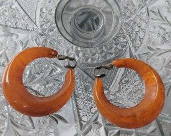 Orange Bakelite Clip On Earrings